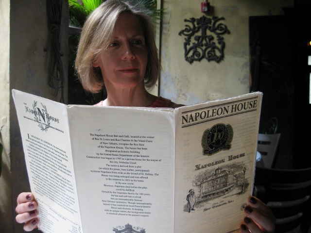 Shannon Selin reading the Napoleon House menu, which inspired her novel, Napoleon in America.