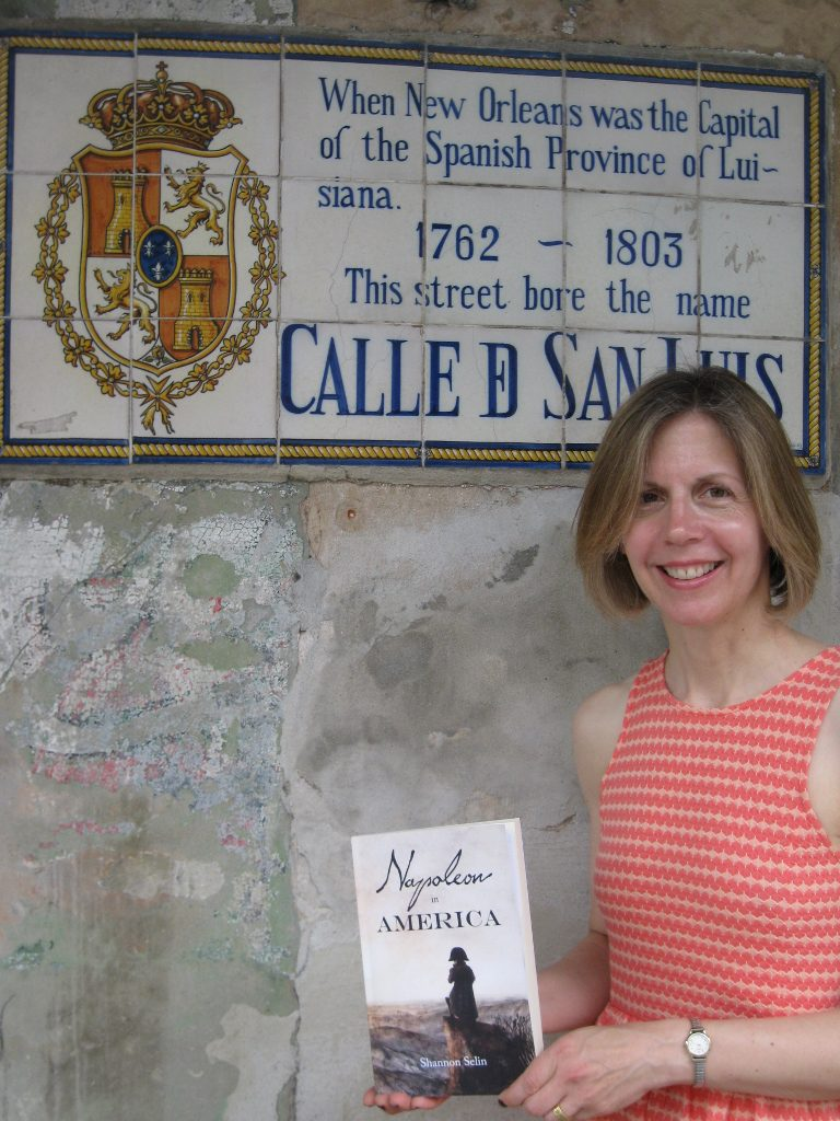 Shannon Selin with her novel Napoleon in America outside Napoleon House in New Orleans