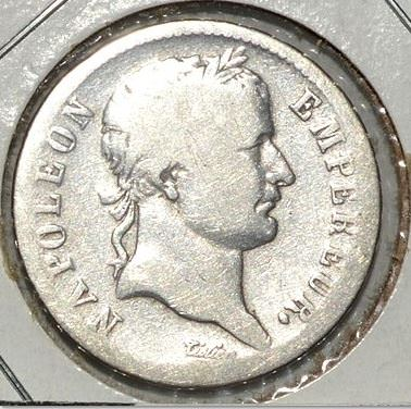 "A silver franc from 1810 with the inscription ""NAPOLEON EMPEREUR"""