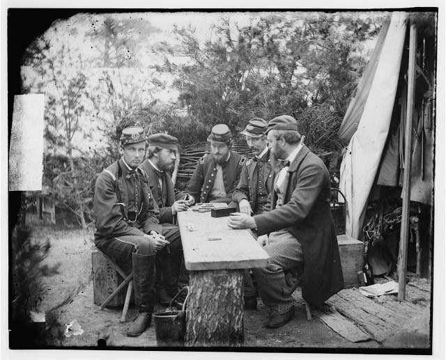 The Duke of Chartres, the Count of Paris, the Prince of Joinville, and friends playing dominoes at Camp Winfield Scott, near Yorktown, Virginia in May 1862, photographed by James Gibson